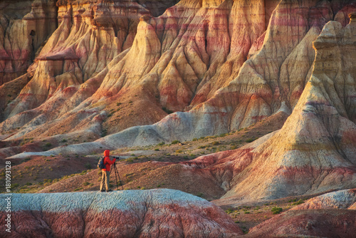 Foto op Canvas Cappuccino A person taking pictures in colorful Mongolian canyons.