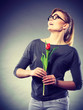 Happy blonde woman with spring flower. - 181094370