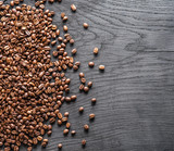 Roasted coffee beans on the old wooden background. Top view. - 181103378