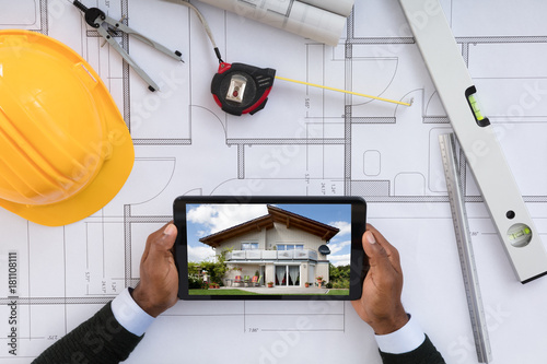 Architect Looking At Digital Tablet