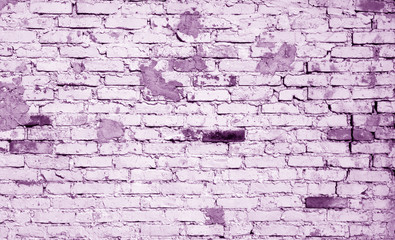 Old weathered brick wall pattern in violet tone