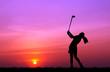 Leinwanddruck Bild - silhouette golfer playing golf during beautiful sunset