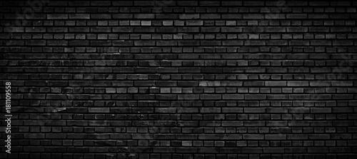 Czarny ceglany mur tło.
