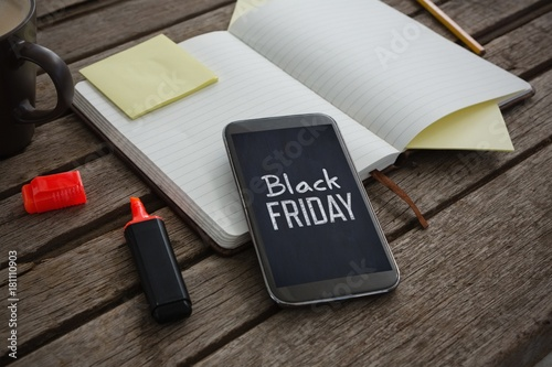 Composite image of organizer, coffee, mobile phone and