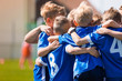 Leinwanddruck Bild - Kids Play Sports. Children Sports Team United Ready to Play Game. Children Team Sport. Youth Sports For Children. Boys in Sports Uniforms. Young Boys in Soccer Sportswear