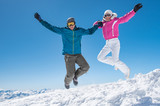 Couple jumping on snow