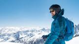Skier in snow mountain