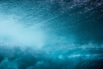 Wave underwater. Blue ocean in underwater