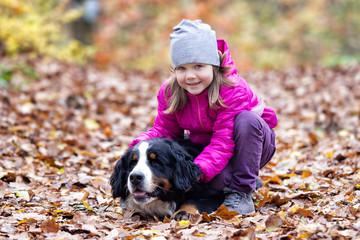 child gently hugs the dog