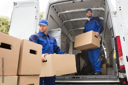 Fototapeta Two Movers Carrying Cardboard Box