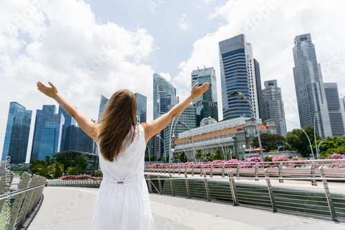 Girl with raised arms in downtown of Singapore
