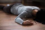 dead woman body lying on floor at crime scene - 181153595