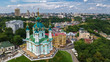 Aerial top view of Saint Andrew's church and Andreevska street from above, cityscape of Podol district, city of Kiev (Kyiv), Ukraine  - 181158175