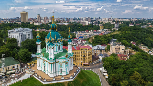 Poster Aerial top view of Saint Andrew's church and Andreevska street from above, cityscape of Podol district, city of Kiev (Kyiv), Ukraine
