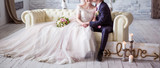 warm embrace of the newlyweds - 181159128