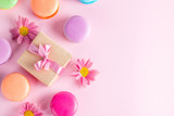 Photo of cake macarons, gift box, tea, coffee, cappuccino and flowers. Sweet romantic food macaroon concept. Morning breakfast and presents. - 181159353