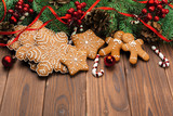 Christmas background with branch of fir tree decorated by gingerbread. - 181163338
