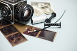 Old photo camera with photo film rolls and cassette