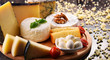 Different sorts of cheese on kitchen table - 181182377