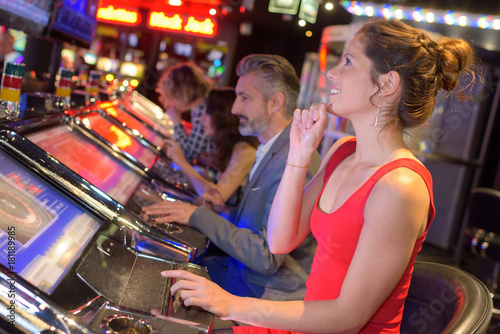 young group of people gambling in a casino