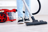 vacuum cleaning the floor - 181195394
