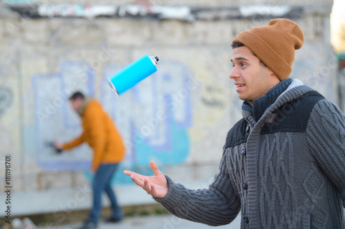 graffiti artist before spraying a brick wall Poster