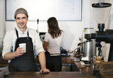 Barista working in a coffee shop - 181208513