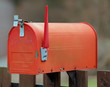 red letterbox with the raised rod to signal the presence of mail