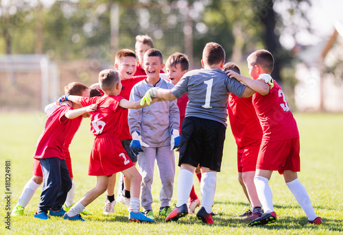 Kids soccer football -  children players celebrating after victory