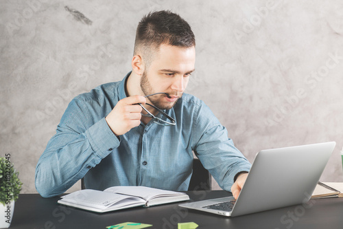 Attractive guy working on project