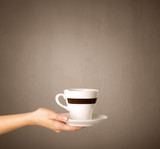 Female hand holding coffee cup