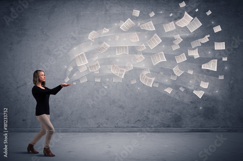 businesswoman holding newspapers Poster