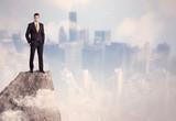 Winner urban businessman on top of stone - 181234324