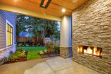 Outside Patio boasts gorgeous stone Fireplace - 181245797