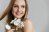 Fototapety Beautiful Smiling Woman With Flowers Portrait
