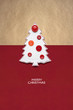 Merry christmas / Creative concept photo of christmas tree made of paper and buttons on red brown background.