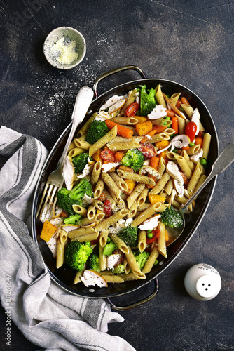 Whole grain penne pasta with vegetable and roasted chicken.Top view. - 181266547