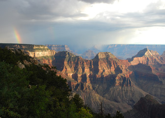 Rainbow during a thunderstorm at sunset at the North Rim of Grand Canyon National Park, Arizona