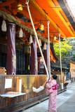 Tourist woman in Yukata Kimono Dress Praying by ringing the golden bell - 181314537