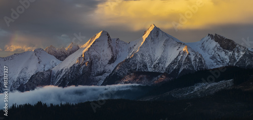 Foto op Canvas Grijs mountain panorama (Tatra Mountains) with multicolored, dramatic sky