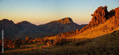 Deurstickers Canarische Eilanden rocks on the Teide volcano in the light of the rising sun