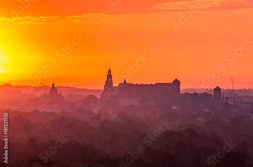 Plexiglas Crimson Krakow, Poland, Wawel castle silhouette at sunrise