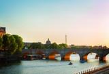 bridge Pont Neuf and Seine river at sunny summer sunset, Paris, France, retro toned