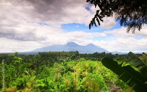 Fotobehang Purper Mountain Field On A Cloudy Sky