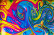 abstract patterns formed by mixing liquid paints..