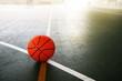 old orange basketball on dark greensport with white line gymnasium indoor floor