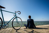Young man with bike on pier - 181339317