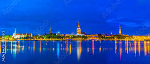 Foto op Canvas Donkerblauw Panorama of riga including the Riga castle, cathedral, Saint Peter and Saint James churches taken during sunset, Latvia.