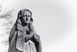 Virgin Mary statue. Vintage sculpture of sad woman in grief (Religion, faith, suffering, love concept) - 181341943