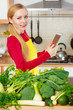 Woman having green vegetables thinking about cooking
